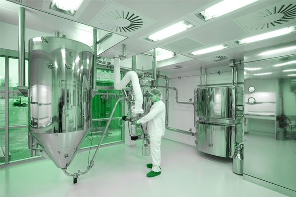 A worker maintaining a cleanroom equipment