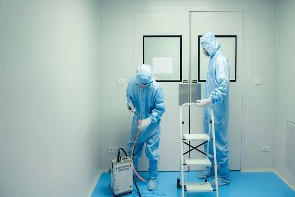 Workers installing cleanroom equipment