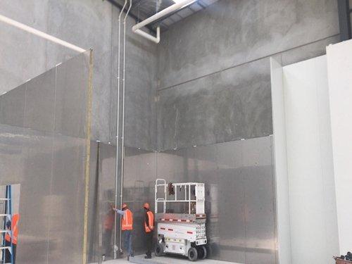 Workers Installing Sandwich Panels